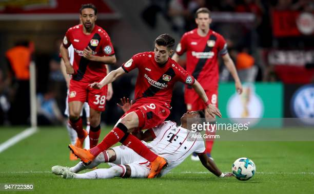 Kai Havertz of Leverkusen and David Alaba of Muenchen battle for the ball during the DFB Cup semi final match between Bayer 04 Leverkusen and Bayern...