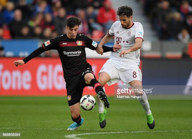 Kai Havertz of Leverkusen and Javi Martinez of FC Bayern Muenchen compete for the ball during the Bundesliga match between Bayer 04 Leverkusen and...