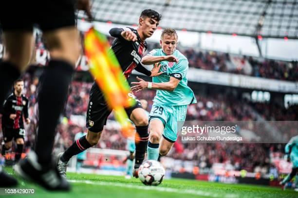 Kai Havertz of Leverkusen and Jonathan Burkardt of Mainz fight for the ball during the Bundesliga match between Bayer 04 Leverkusen and 1 FSV Mainz...