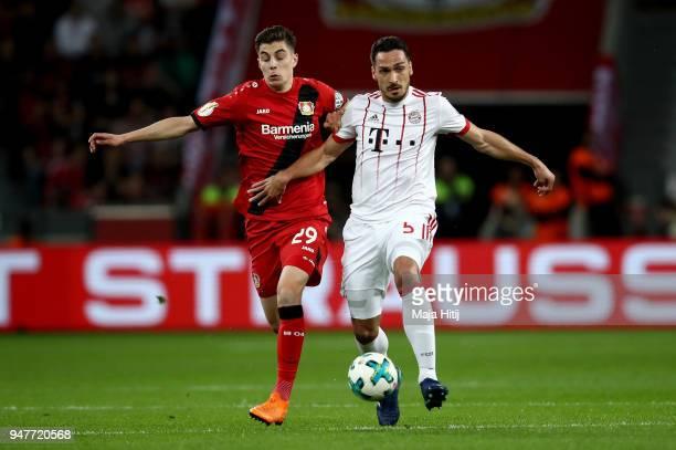 Kai Havertz of Leverkusen and Mats Hummels of Muenchen battle for the ball during the DFB Cup semi final match between Bayer 04 Leverkusen and Bayern...