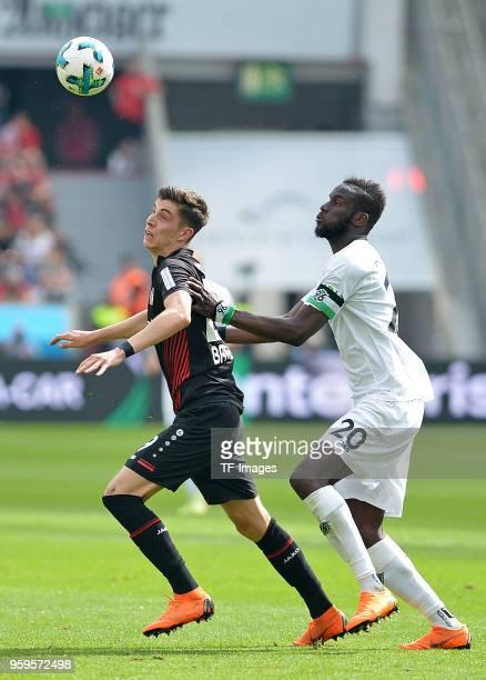 Kai Havertz of Leverkusen and Salif Sane of Hannover battle for the ball during the Bundesliga match between Bayer 04 Leverkusen and Hannover 96 at...