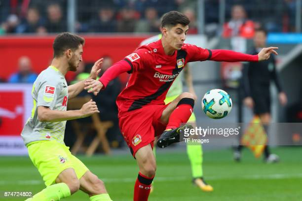 Kai Havertz of Leverkusen and Salih Oezcan of Koeln battle for the ball during the Bundesliga match between Bayer 04 Leverkusen and 1 FC Koeln at...