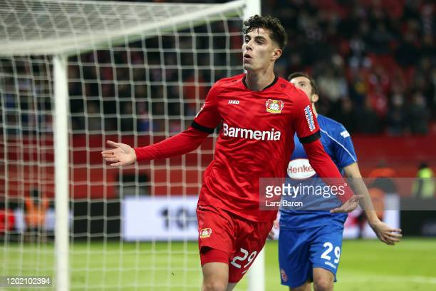 Kai Havertz of Leverkusen celebrates his team's first goal as Markus Suttner of Duesseldorf reacts during the Bundesliga match between Bayer 04...