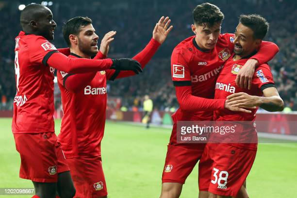 Kai Havertz of Leverkusen celebrates his team's first goal with team mate Karim Bellarabi during the Bundesliga match between Bayer 04 Leverkusen and...