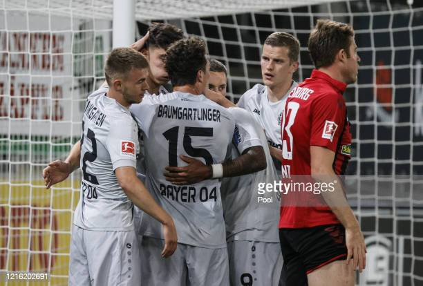 Kai Havertz of Leverkusen celebrates with team mates after he scores his sides first goal during the Bundesliga match between Sport-Club Freiburg and...
