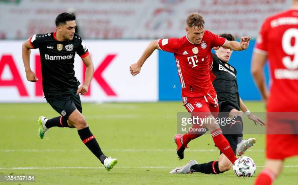 Kai Havertz of Leverkusen in action against Joshua Kimmich of Bayern Muenchen during the DFB Cup final match between Bayer 04 Leverkusen and FC...