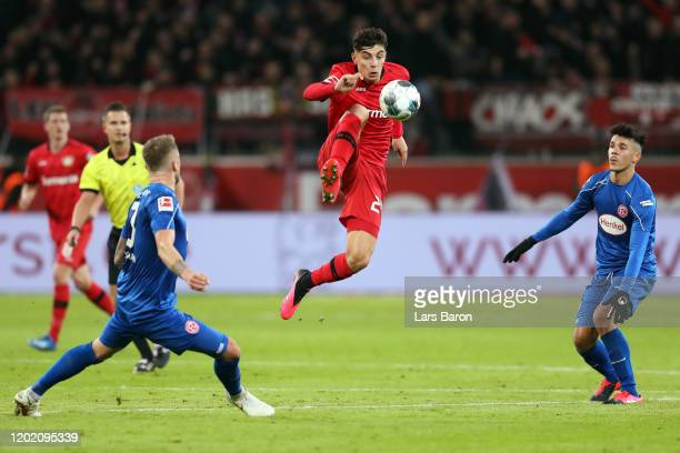 Kai Havertz of Leverkusen is challenged by Andre Hoffmann and Alfredo Morales of Duesseldorf during the Bundesliga match between Bayer 04 Leverkusen...