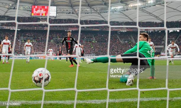 Kai Havertz of Leverkusen scores his team's first goal by penalty past Goalkeeper RonRobert Zieler of Stuttgart during the Bundesliga match between...
