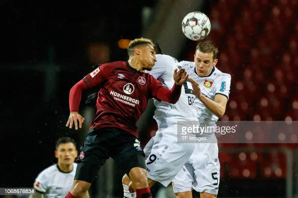 Kai Havertz of Leverkusen Sven Bender of Leverkusen and Kevin Goden of Nuernberg battle for the ball during the Bundesliga match between 1 FC...