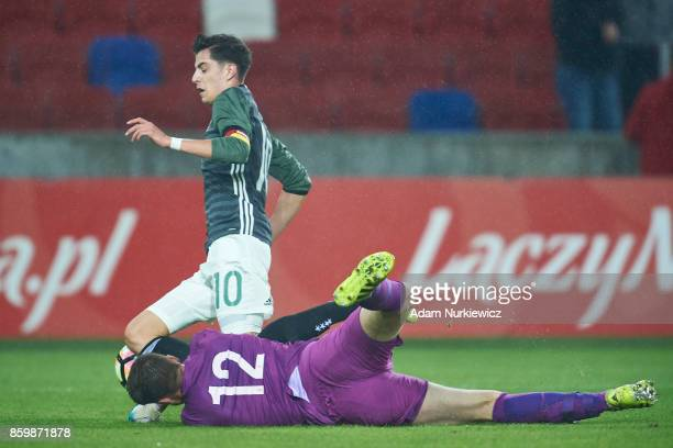 Kai Havertz of U19 Germany fights for the ball with goalkeeper Marcin Bulka of U19 Poland during soccer match U19 Poland v U19 Germany UEFA Under19...