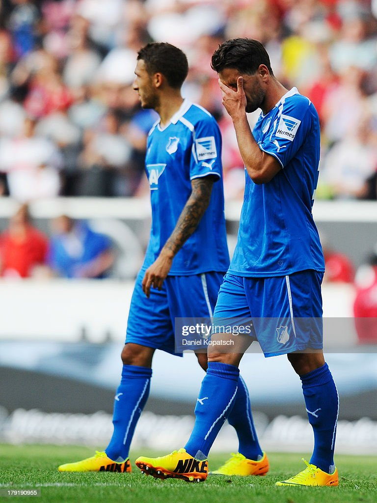 Kai Herdling of Hoffenheim (R) reacts after the Bundesliga match between VfB Stuttgart and 1899 Hoffenheim at Mercedes-Benz Arena on September 1, 2013 in Stuttgart, Germany.