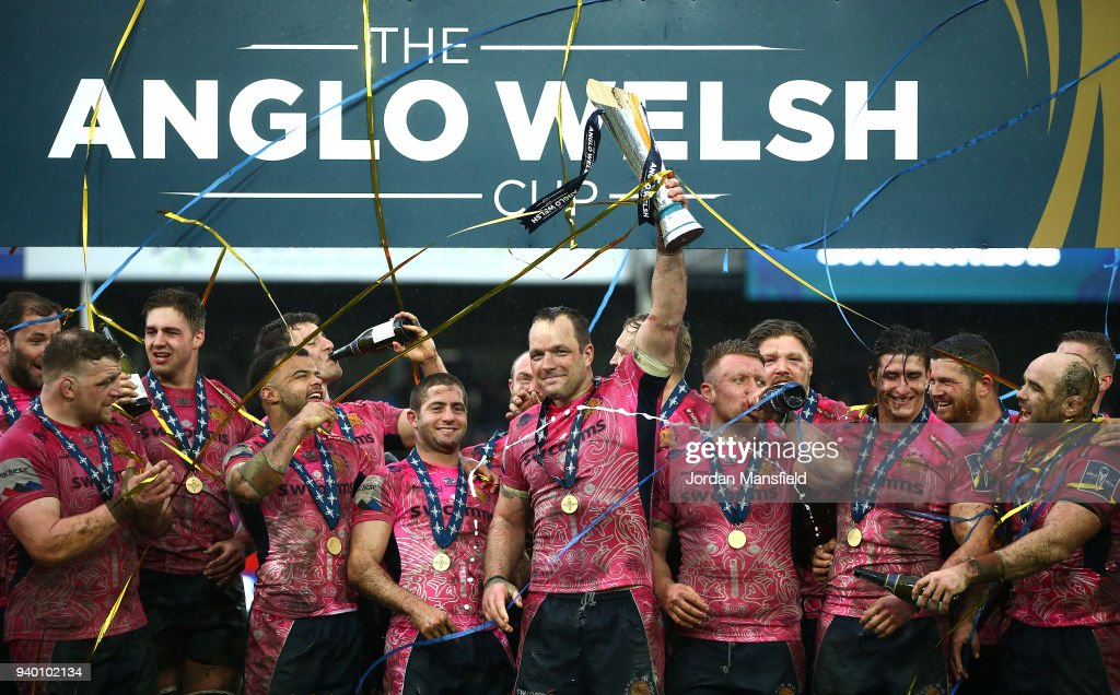 Kai Horstmann of Exeter Chiefs lifts the Anglo-Welsh Cup after wiining the Final between Bath Rugby and Exeter Chiefs at Kingsholm Stadium on March 30, 2018 in Gloucester, England.