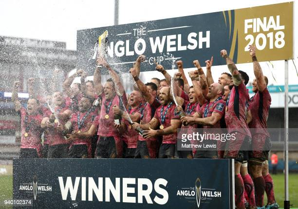 Kai Horstmann of Exeter Chiefs lifts the AngloWelsh Cup trophy and celebrates with team mates after winning the Final between Bath Rugby and Exeter...