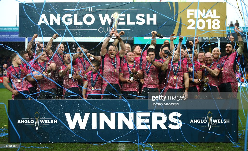 Kai Horstmann of Exeter Chiefs lifts the Anglo-Welsh trophy and celebrates with team mates after winning the Final between Bath Rugby and Exeter Chiefs at Kingsholm Stadium on March 30, 2018 in Gloucester, England.