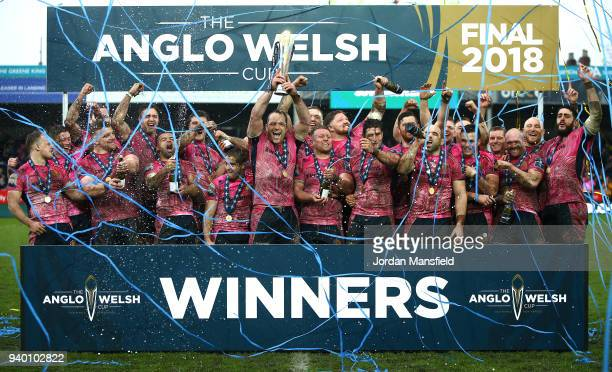 Kai Horstmann of Exeter Chiefs lifts the AngloWelsh trophy and celebrates with team mates after winning the Final between Bath Rugby and Exeter...