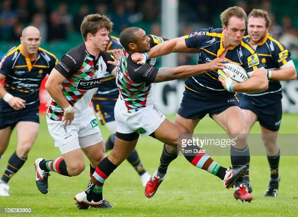 Kai Horstmann of Worcester Warriors is tackled by Jordan TurnerHall of Harlequins during the AVIVA Premiership match between Worcester Warriors and...