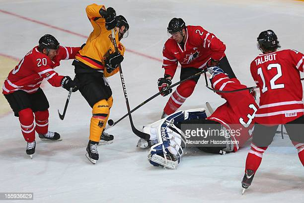 Kai Hospelt of Germany battles with goalie Sebastien Caron of Canada and his team mates Roy Mathieu , Julian Talbot and Connor James during the...