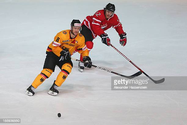 Kai Hospelt of Germany skates with Julian Talbot of Canada during the German Ice Hockey Cup 2012 first round match between Germany and Canada at...