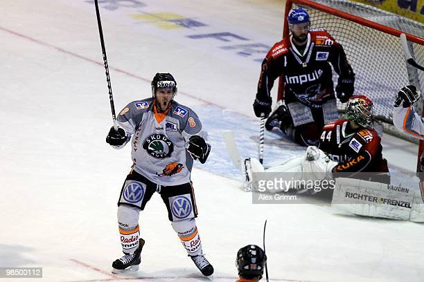 Kai Hospelt of Wolfsburg celebrates his team's first goal during the fourth DEL playoff semi final game between Augsburger Panther and Grizzly Adams...