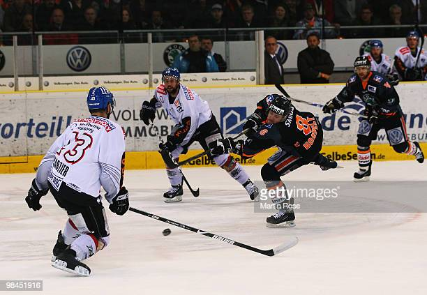Kai Hospelt of Wolfsburg fires at shot at goal during the third DEL play off semi final match between Grizzly Adams Wolfsburg and Augsburger Panther...
