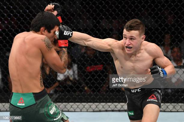 Kai Kara France of New Zealand punches Elias Garcia in their flyweight bout during the UFC Fight Night event inside Adelaide Entertainment Centre on...
