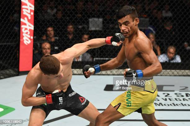 Kai Kara France of New Zealand punches Raulian Paiva of Brazil in their flyweight bout during the UFC 234 at Rod Laver Arena on February 10, 2019 in...