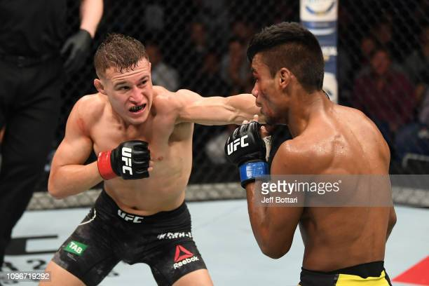 Kai Kara France of New Zealand punches Raulian Paiva of Brazil in their flyweight bout during the UFC 234 at Rod Laver Arena on February 10 2019 in...