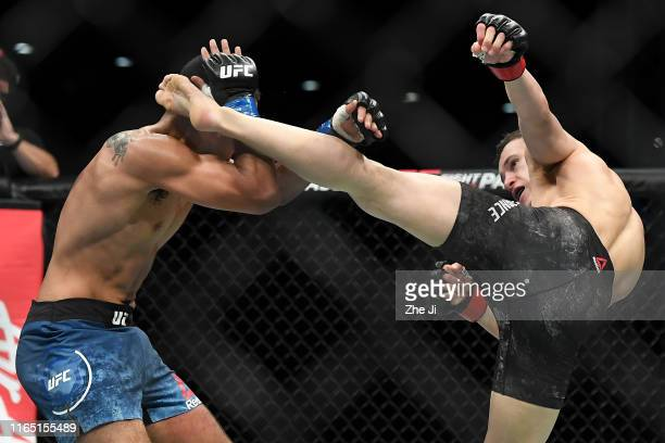 Kai KaraFrance of New Zealand kicks Mark De La Rosa in their flyweight bout during the UFC Fight Night event at Shenzhen Universiade Sports Centre on...