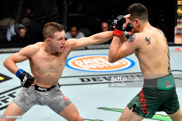 Kai KaraFrance of New Zealand punches Brandon Moreno of Mexico in their flyweight bout during the UFC 245 event at TMobile Arena on December 14 2019...