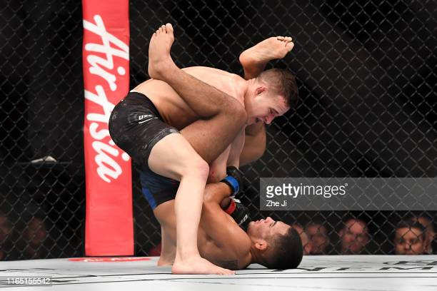 Kai KaraFrance of New Zealand punches Mark De La Rosa in their flyweight bout during the UFC Fight Night event at Shenzhen Universiade Sports Centre...