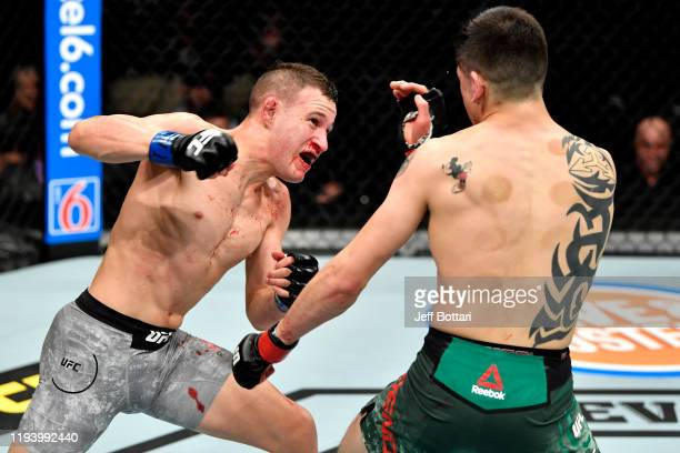 Kai KaraFrance of New Zealand strikes at Brandon Moreno of Mexico in their flyweight bout during the UFC 245 event at TMobile Arena on December 14...