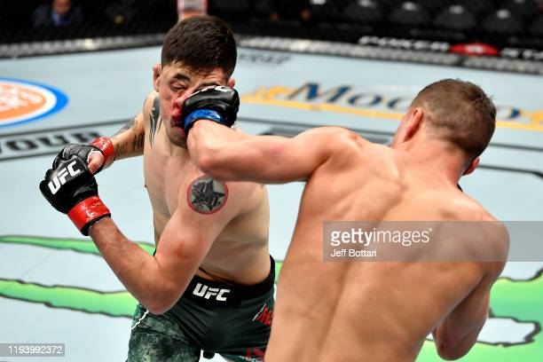 Kai Kara-France of New Zealand strikes Brandon Moreno of Mexico in their flyweight bout during the UFC 245 event at T-Mobile Arena on December 14,...