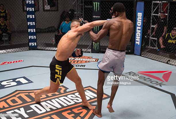 Kai KaraFrance punches Terrence Mitchell during the filming of The Ultimate Fighter Team Benavidez vs Team Cejudo at the UFC TUF Gym on July 13 2016...