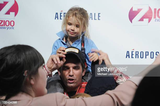 Kai Madison Trump sits on her father Donald Trump Jr's shoulders at Z100's Jingle Ball 2011 presented by Aeropostale Madison Square Garden on...