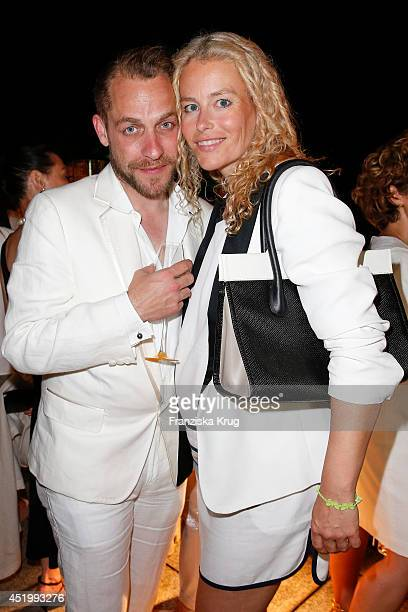 Kai Margranda and Kerstin Schneider attend the Burda Style Cocktail on July 10 2014 in Berlin Germany