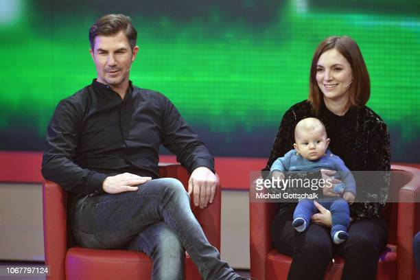 Kai Michalke and Ramona Isaac with Baby Leon speak on stage during the tv show '2018 Menschen Bilder Emotionen' on December 3 2017 in Cologne Germany