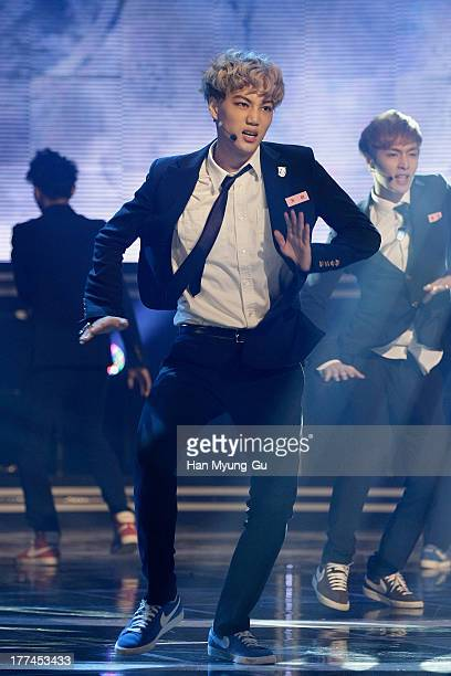 Kai of boy band EXO performs onstage during the MBC Music 'Show Champion' at the UniqloAX Hall on August 21 2013 in Seoul South Korea