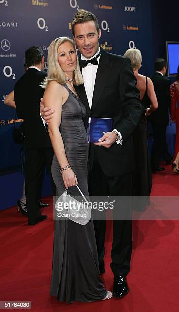 Kai Pflaume and his wife Ilke arrive at the Bambi Awards 2004 at the Theater im Hafen on November 18 2004 in Hamburg Germany