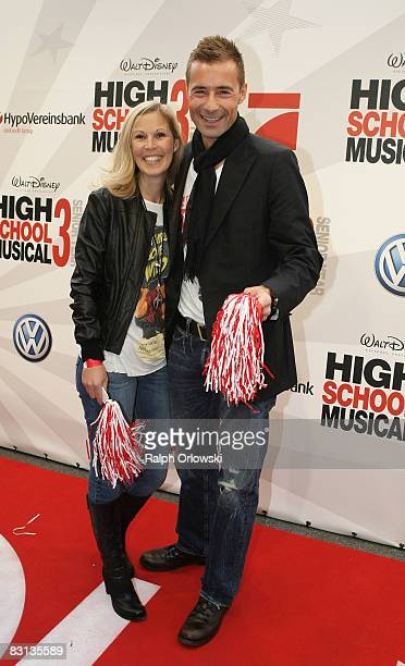 Kai Pflaume and his wife Ilke smile prior to the German premiere of 'High School Musical 3 Senior Year' on October 5 2008 in Munich Germany