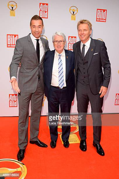 Kai Pflaume Frank Elstner and Joerg Pilawa attends 'Goldenes Lenkrad' Award 2014 at Axel Springer Haus on November 11 2014 in Berlin Germany