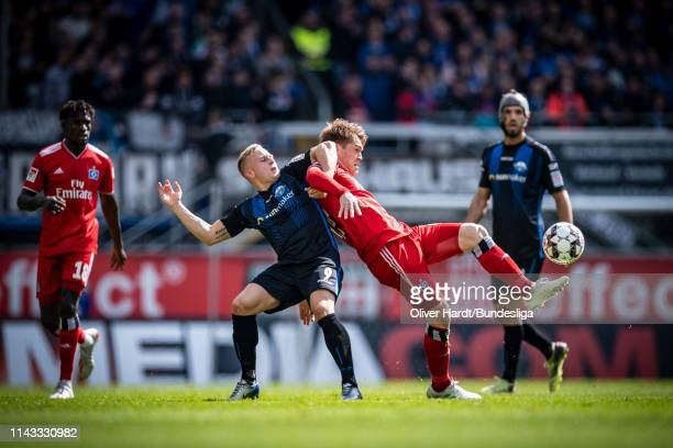 Kai Proeger of SC Paderborn challenges for the ball with Gotoku Sakai of Hamburger SV during the Second Bundesliga match between SC Paderborn and...