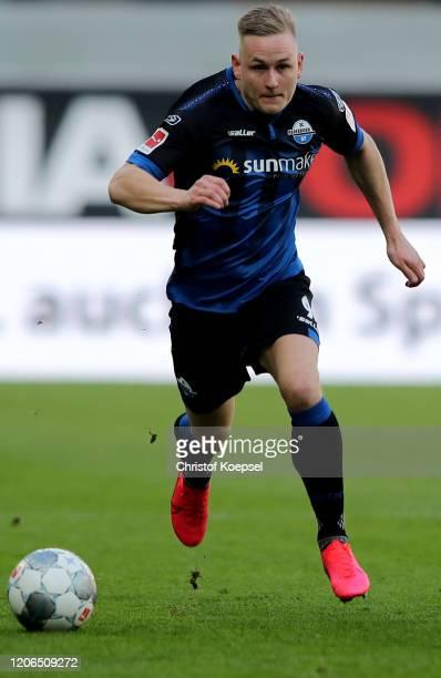 Kai Proegerof Paderborn runs with the ball during the Bundesliga match between SC Paderborn 07 and Hertha BSC at Benteler Arena on February 15 2020...
