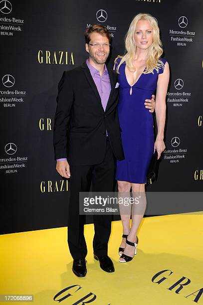 Kai Rose and Franziska Knuppe attend the MercedesBenz Fashion Week Berlin Spring/Summer 2014 Preview Show by Grazia at the Brandenburg Gate on July 1...