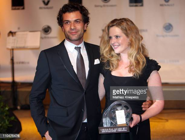 Kai Schumann and Diana Amft present the trophy at the 2nd Orange Filmball Vienna at the Townhall on March 18, 2011 in Vienna, Austria.