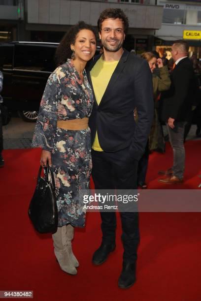 Kai Schumann and partner Mava Schreiber attend 'Spielmacher' Premiere at Lichtburg on April 10, 2018 in Essen, Germany.