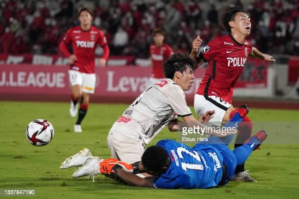 Kai Shibato of Urawa Red Diamonds pushes down Yasuto Wakizaka of Kawasaki Frontale during the J.League YBC Levain Cup quarter final first leg between...