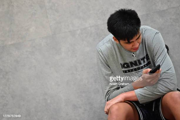 Kai Sotto of Team Ignite looks at his phone during an NBA G League Practice and Scrimmage on November 21, 2020 at Ultimate Fieldhouse in Walnut...