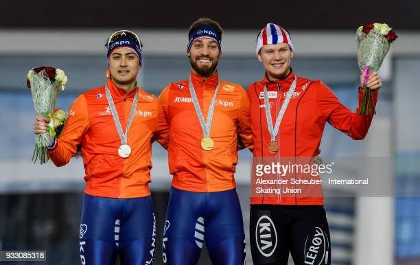 Kai Verbij of the Netherlands Kjeld Nuis of the Netherlands and Havard Holmefjord Lorentzen of Norway stand on the podium after the Men's 1000m Final...