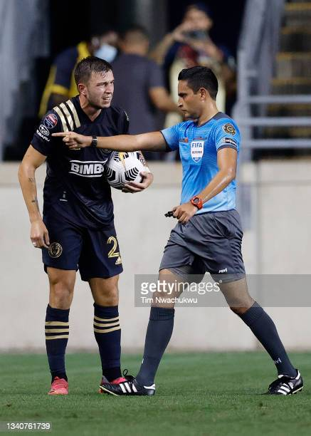 Kai Wagner of Philadelphia Union speaks with referee Said Martinez during the semifinal second leg match of the CONCACAF Champions League 2021 at...
