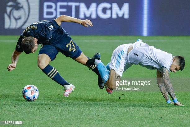 Kai Wagner of the Philadelphia Union is tackled by Gustavo Bou of the New England Revolution during the second half at Subaru Park on May 12, 2021 in...